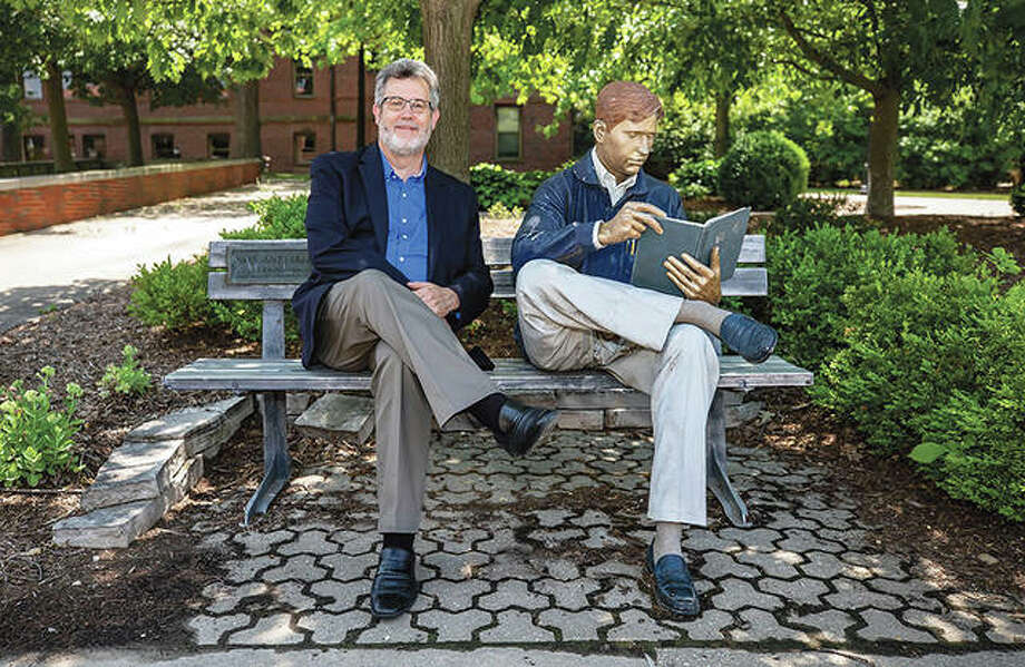 James Reynolds sits with the Bronze Man on the campus of Millikin University in Decatur. Reynolds started his duties as the new president of the university July 1. He is a Decatur native. Photo: Clay Jackson | Herald & Review (AP)