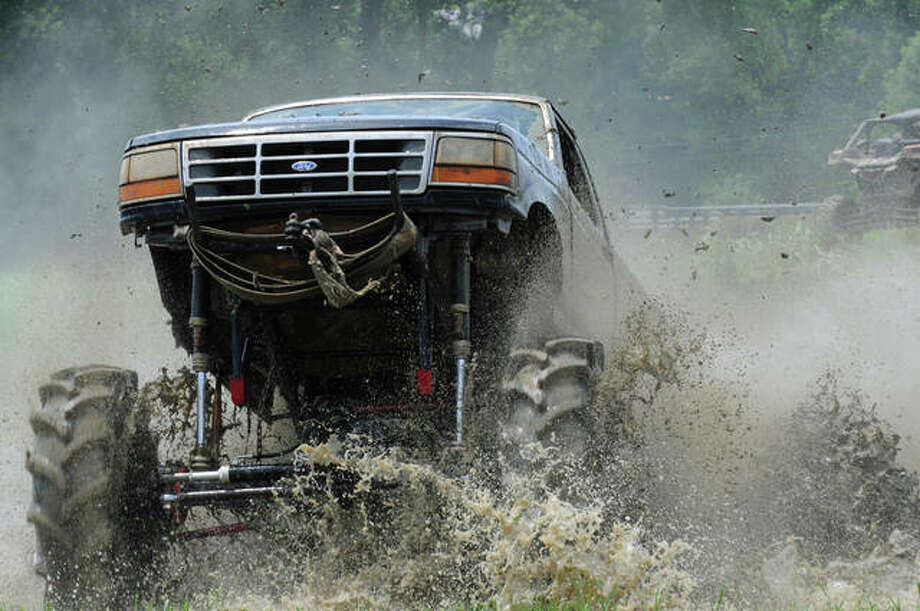 """Adam Emge's """"Thunder Buzzard"""" enters the mud pit during the Independence Mudfest near Otterville. Photo: David Blanchette 