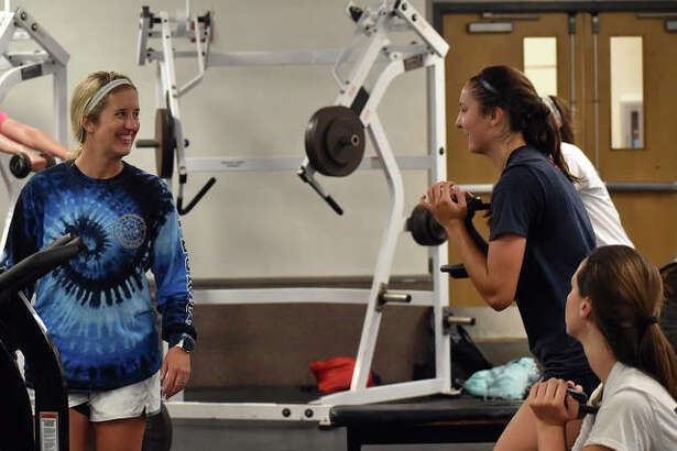 Edwardsville girls basketball coach Caty Ponce, left, talks to her players during a weightlifting session last week at EHS.