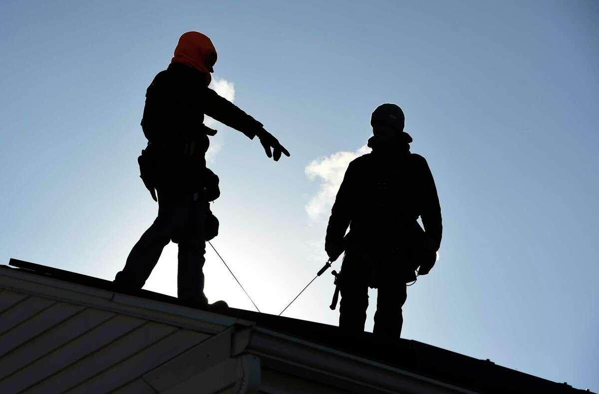 Vivint Solar installers at work in January 2015 in Albany, N.Y.