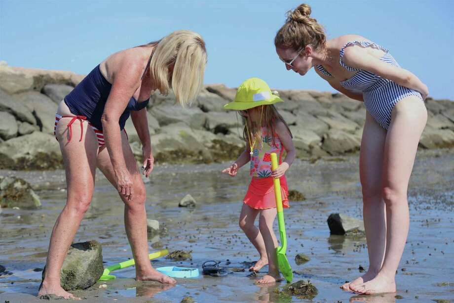 Exploring the low tide are Claire Cassidy, left, of Newport Beach, Calif., her grand daughter Wyatt, 4, of Westport, and Ashby Sussman, Wyatt's aunt, of New York City, at Compo Beach on Saturday, July 4, 2020, in Westport, Conn. Photo: Jarret Liotta / Jarret Liotta / ©Jarret Liotta 2020
