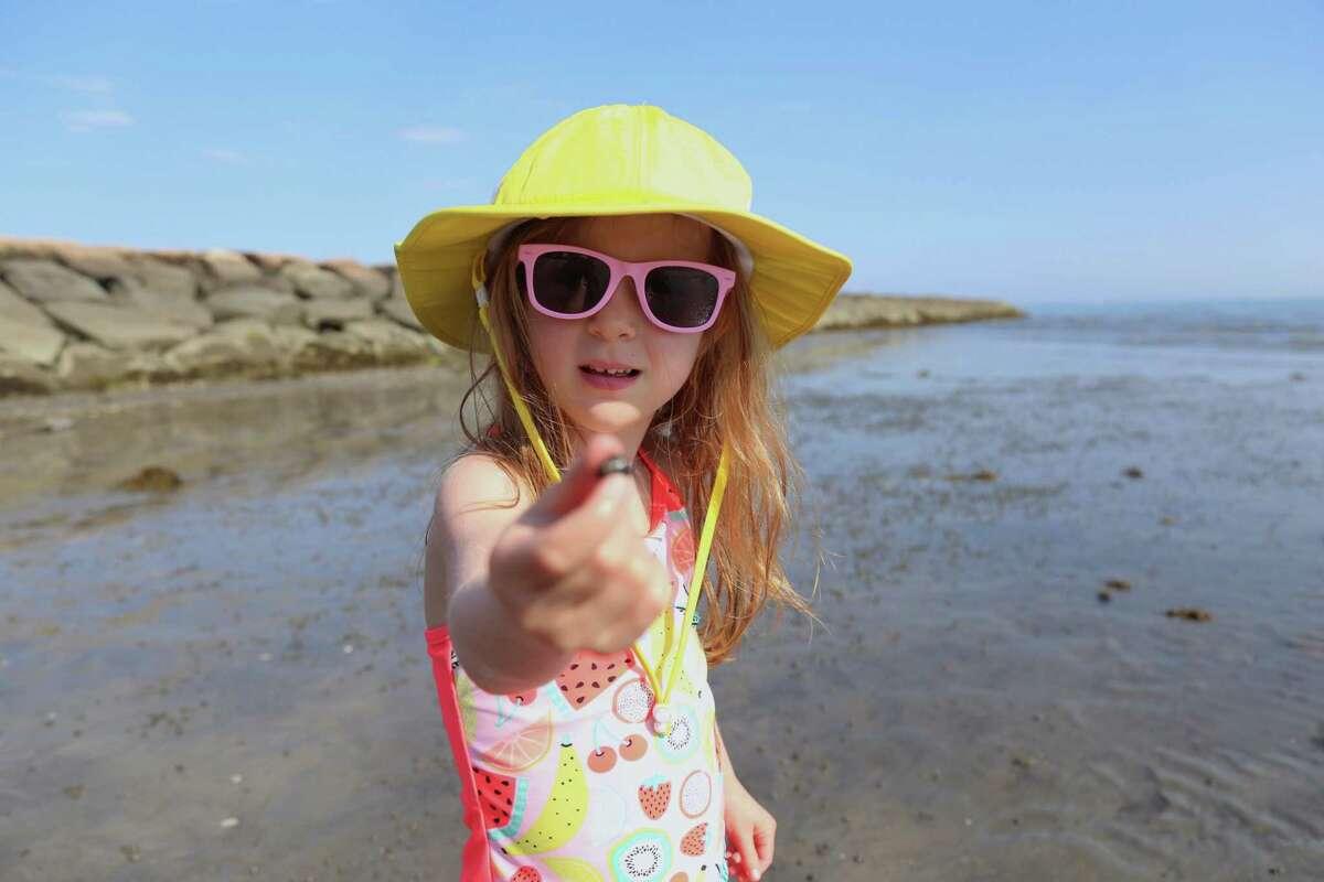 Wyatt Cassidy, 4, of Westport, shares a hermit crab she found at Compo Beach on Saturday, July 4, 2020, in Westport, Conn.
