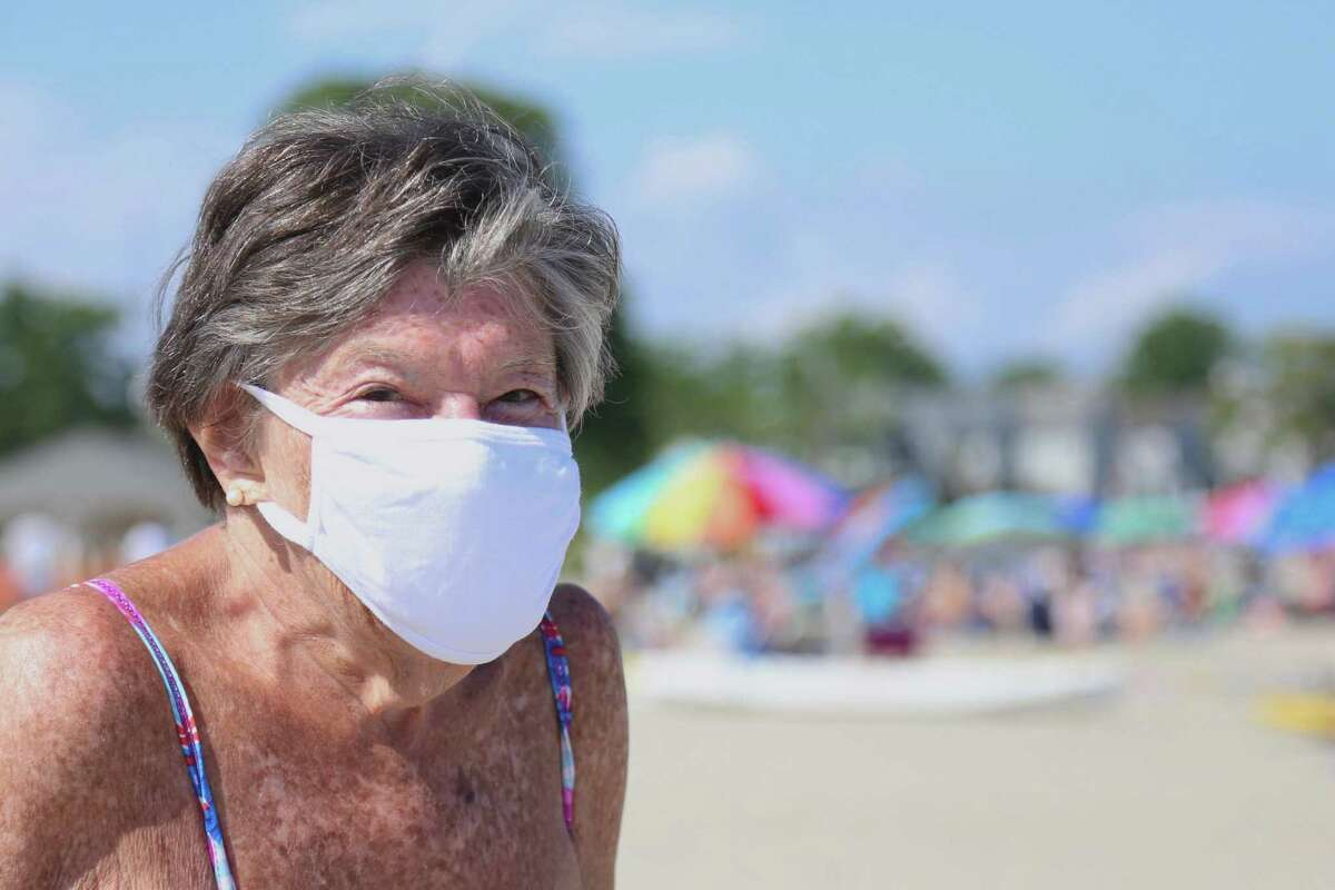 Joan Weinstein of Weston kept her mask on at Compo Beach on Saturday, July 4, 2020, in Westport, Conn.