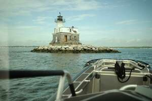The Penfield Lighthouse marks the end of a dangerous reef the causes many of the boating accident calls for the Fairfield Police Marine Unit.