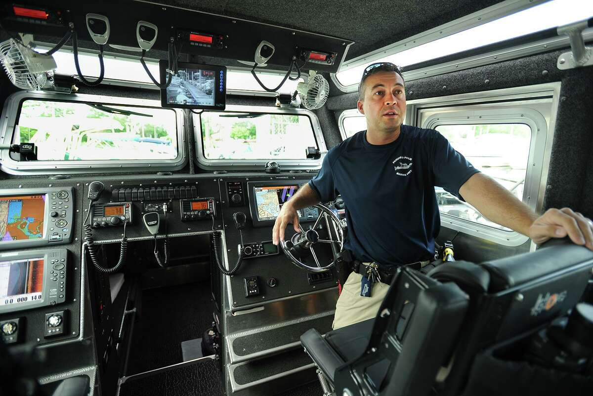 Fairfield Police Marine Unit Officer Jim Wiltsie embarks on a patrol on the unit's state-of-the-art police boat from South Benson Marina in Fairfield, Conn. on Wednesday, July 3, 2013. Wiltsie said the days surrounding the July 4 holiday, because of the many fireworks displays on the Sound, are the units busiest of the year.