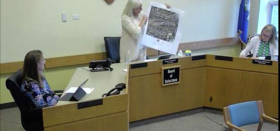 Darien First Selectman Jayme Stevenson holds up a map of the area of the new COVID-19 test site at Monday's Board of Selectmen meeting. Photo: Darien TV79 / / Connecticut Post