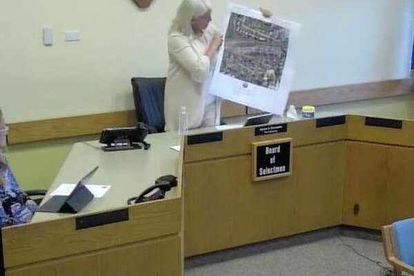 Darien First Selectman Jayme Stevenson holds up a map of the area of the new COVID-19 test site at Monday's Board of Selectmen meeting.