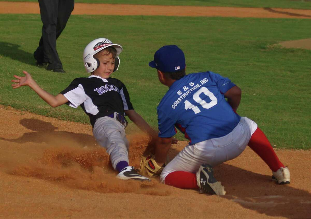 Rangers third baseman Adam Antu (10) applies the tag on Rockies youngster Chad Hill during Monday's contest at Ruth Minchen Field.
