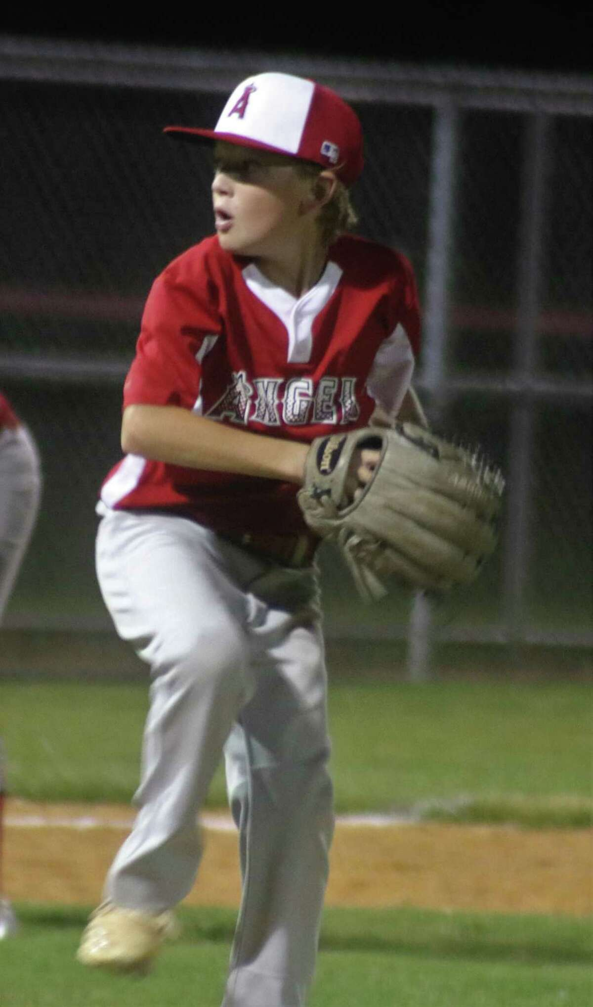 Colt Marlow goes into his wind-up during his three innings of almost pitching a perfect game. The southpaw struck out four in helping the Angels win convincingly.