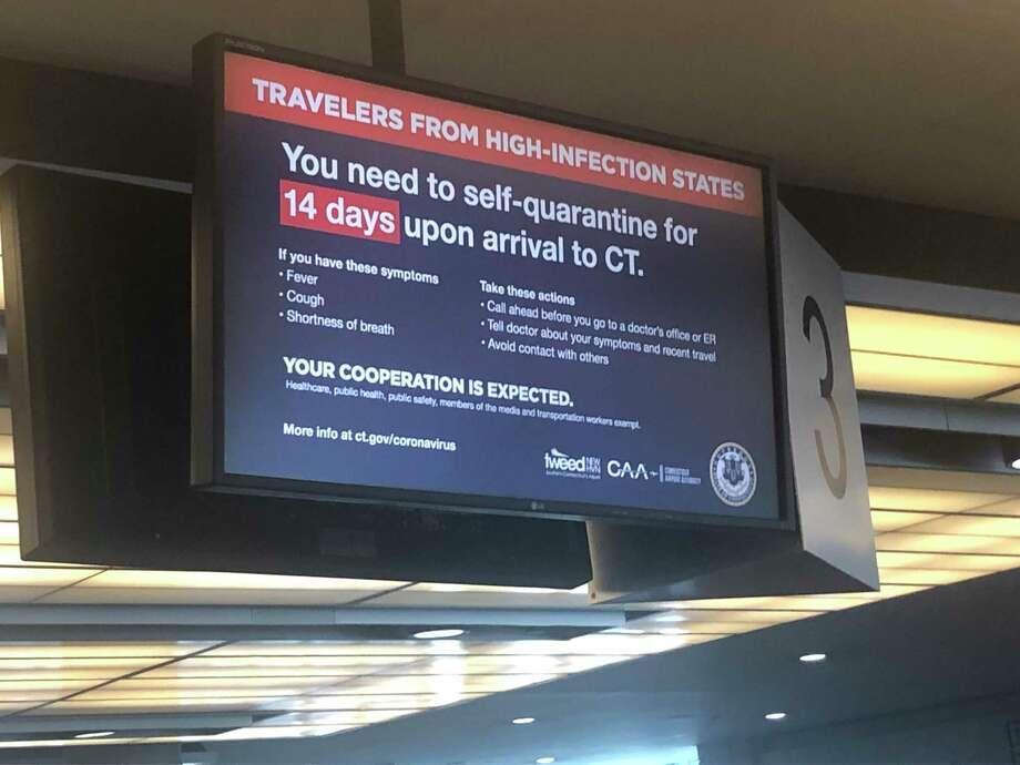 A sign at Bradley International Airport warns travelers on June 25, 2020 of a mandatory 14-day quarantine imposed by the governors of New York, Connecticut and New Jersey. Photo: Kaitlyn Krasselt / Hearst Connecticut Media