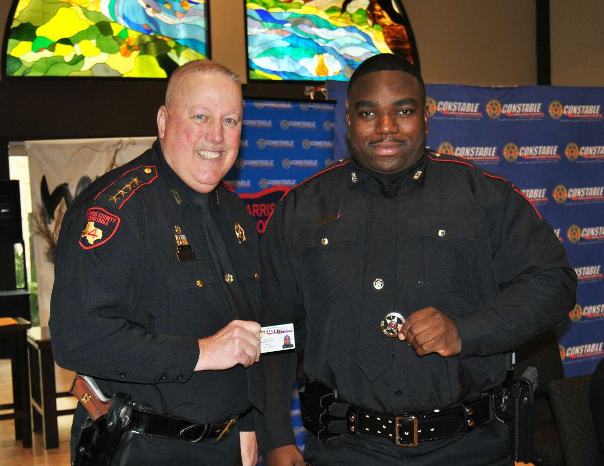 Deputy Christopher Hendrix, right, is seen with Harris County Precinct 4 Constable Mark Herman during a swearing-in ceremony. Hendrix was shot while responding to a domestic disturbance Tuesday, July 7, 2020.