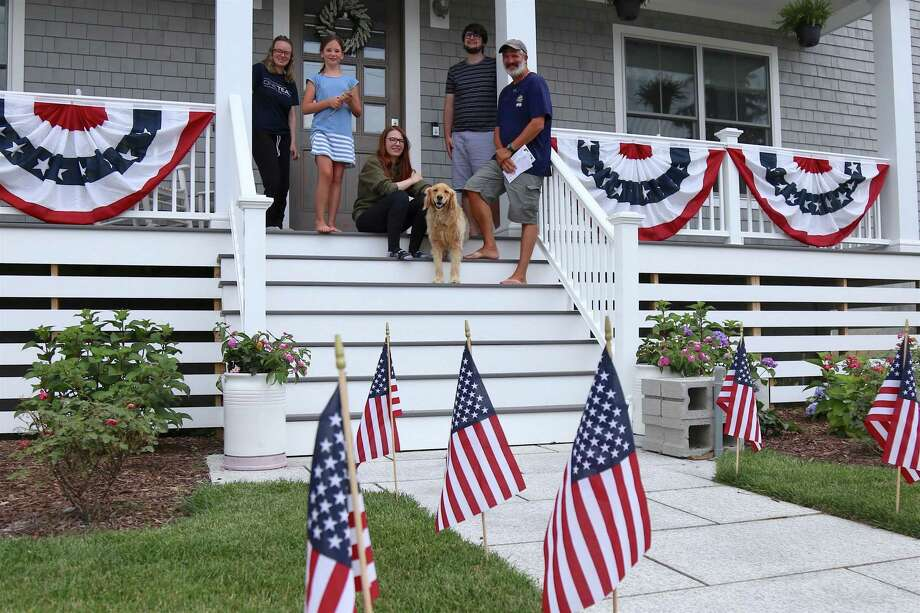 The Bowen family of Fairfield poses amidst their holiday decorations on Friday, July 3, 2020, in Fairfield, Conn. Photo: Jarret Liotta / Jarret Liotta / ©Jarret Liotta 2020