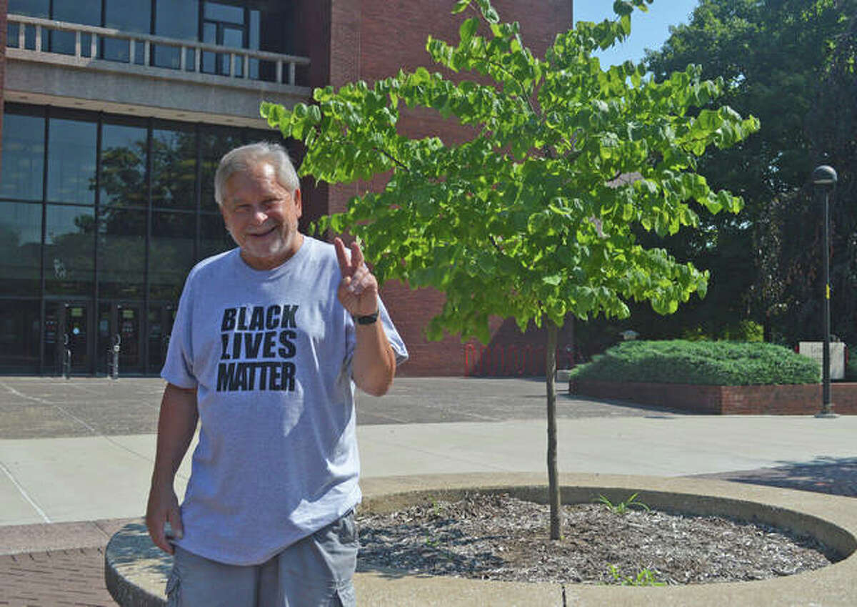 Greg Mudge poses in front of the Lovejoy Library on the SIUE campus. Fifty years ago, Mudge was among the student protesters at SIUE after four students at Kent State University were shot and killed by the Ohio National Guard