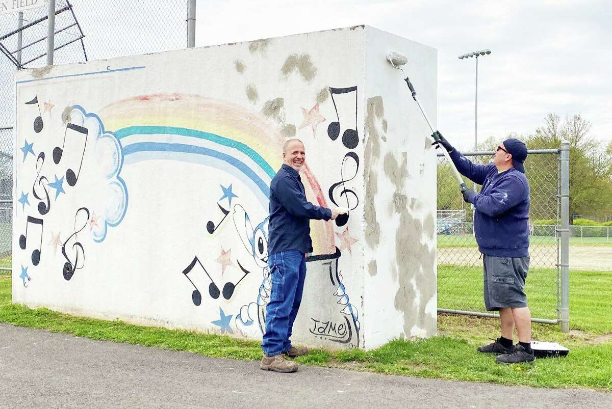 Cromwell Creative District and Cromwell High School's National Arts Honor Society have teamed up to showcase the new dugout murals at Pierson Park. Cromwell maintenance crew prep the dugouts for new murals.