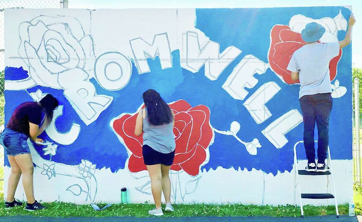 Cromwell Creative District and Cromwell High School's National Arts Honor Society have teamed up to showcase the new dugout murals at Pierson Park. Shown here is the Celebrating Cromwell rose town mural: a work in process.