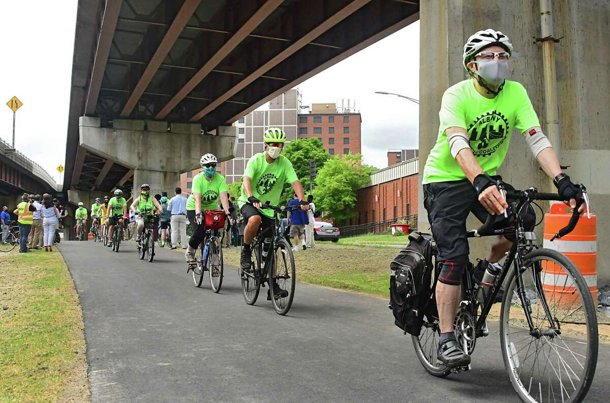 Members of the Albany Bicycle Coalition take off for the inaugural ride after Mayor Kathy Sheehan highlighted the substantial completion of Phase One of the South End Connector on Tuesday, July 7, 2020 in Albany, N.Y. The South End Connector is the connection between the Albany County Helderberg-Hudson Rail Trail and the Mohawk Hudson Hike-Bike Trail. (Lori Van Buren/Times Union)