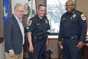 Mayor Mark Boughton, left, Sargent Jim Antonelli, Chief Patrick Ridenhour and Rocky the city's new police dog, in the mayor's City Hall office. Wednesday, March 1, 2017, in Danbury, Conn. Rocky is assigned to the Community Conditions Unit.