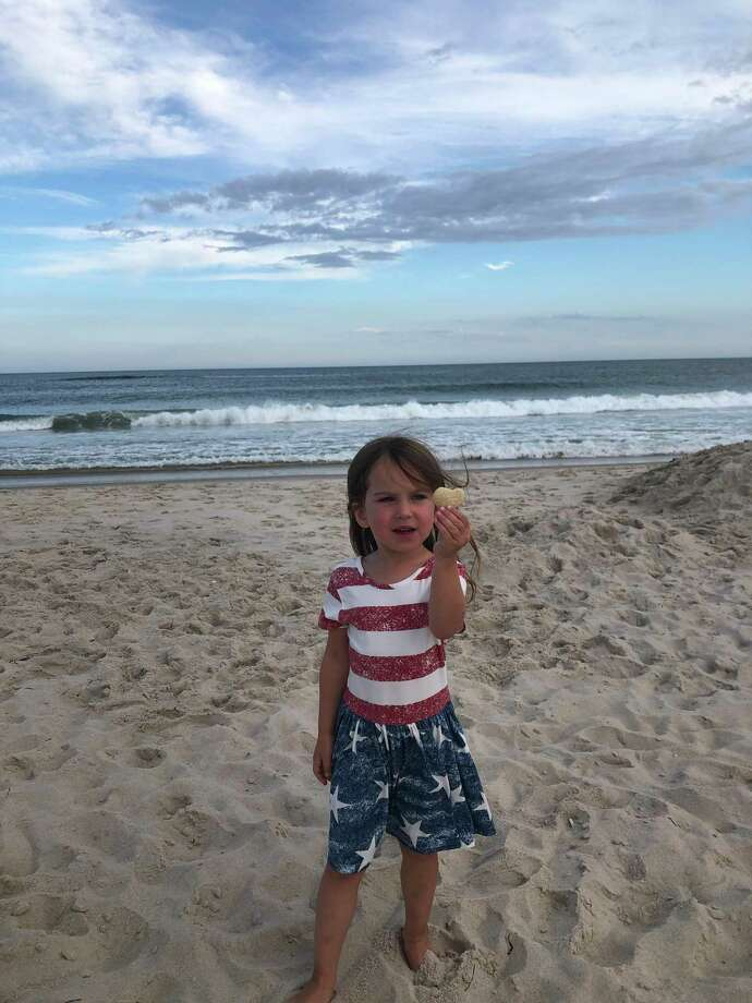 Caroline Plaxsun finds a heart rock. Darien Nature Center is partnering with other community organizations and businesses to hold a fun summer challenge for the community. Photo: Darien Nature Center /