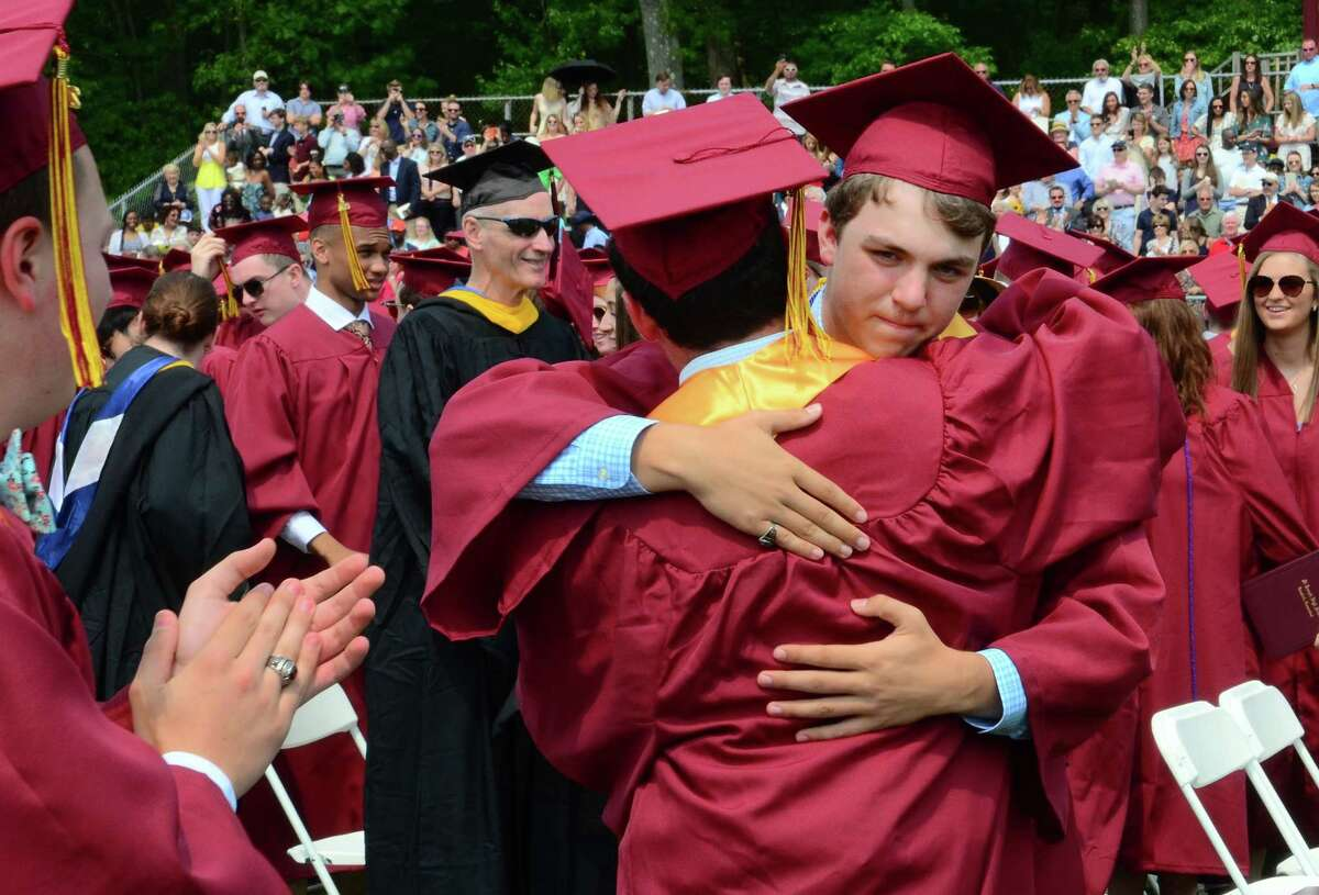 Graduate Ben Talbot hugs fellow grad Jim Evans during Notre Dame of Fairfield's Commencement Exercies in Fairfield, Conn., on Friday May 31, 2019.