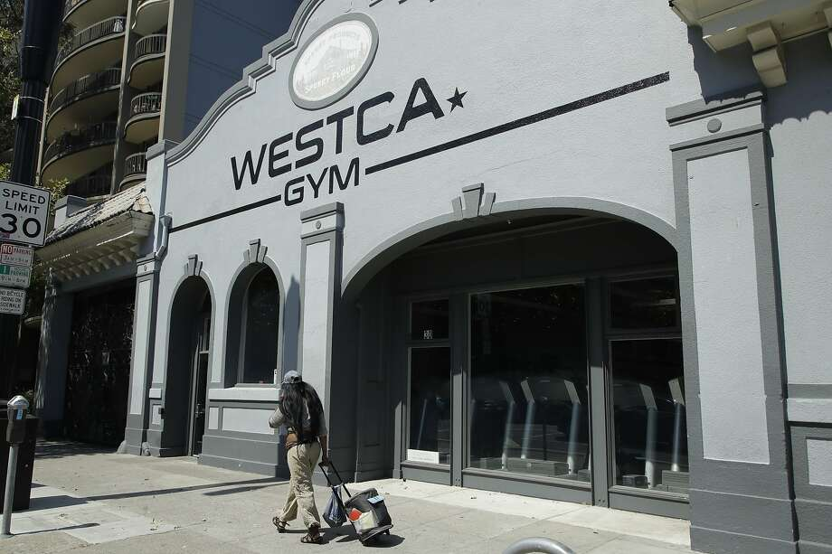 A person walks past the closed Westca Gym on Monday, July 6, 2020, in San Jose, Calif. The Independence Day weekend saw one of Santa Clara County's largest increases in COVID-19 cases to date, which came as the state of California denied the county's application for further reopening of businesses and activities. Photo: Ben Margot, Associated Press
