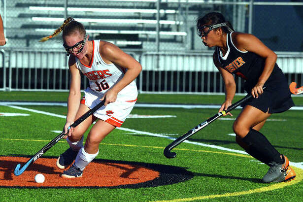 Edwardsville's Mattie Norton, left, controls the ball during a home against Webster Groves during her senior season.