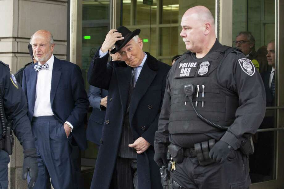 Roger Stone, former adviser to Donald Trump's presidential campaign, with hat at center, exits federal court in Washington, D.C., on Feb. 20, 2020. MUST CREDIT Bloomberg photo by Stefani Reynolds Photo: Stefani Reynolds, Bloomberg / Bloomberg