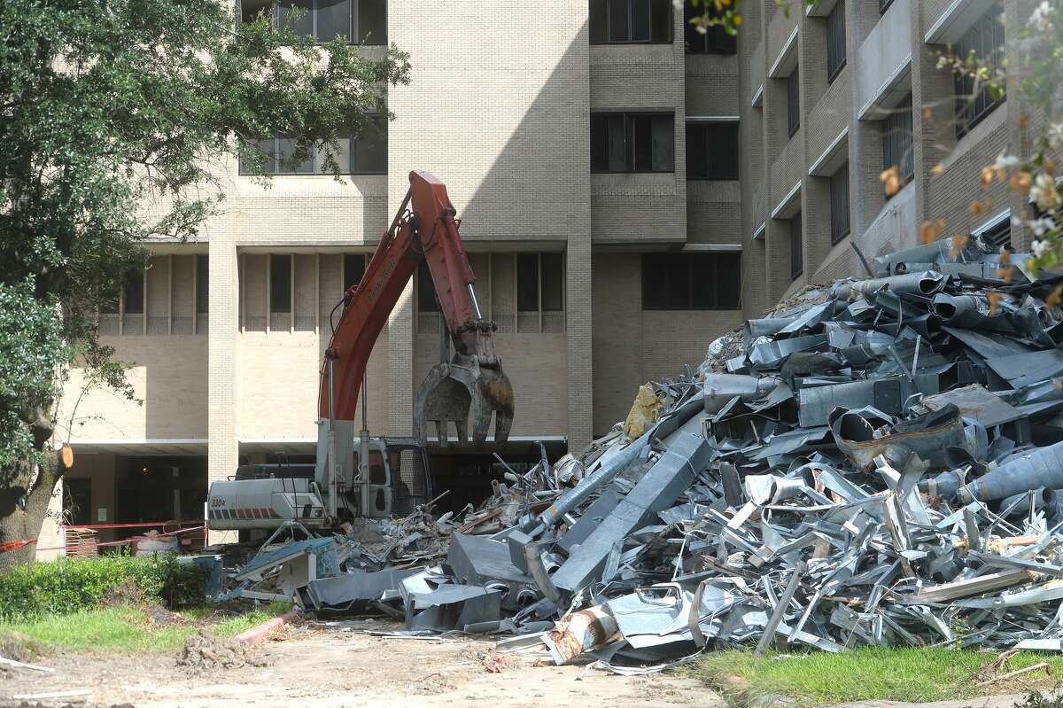 Scraps of metal and concrete lay in oiles as demolition continues on the former Christus St. Mary Hospital in Port Arthur, which closed last year. Photo taken Tuesday, July 7, 2020 Kim Brent/The Enterprise