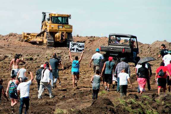 (FILES) In this file photo taken on September 3, 2016 Native American protestors and their supporters are confronted by security during a demonstration against work being done for the Dakota Access Pipeline (DAPL) oil pipeline, near Cannon Ball, North Dakota. - A US judge on June 6 ordered the closure, at least temporarily, of the Dakota Access Pipeline, which has been the subject of dispute and massive protest for years by Native American tribes and environmental groups. (Photo by Robyn BECK / AFP) (Photo by ROBYN BECK/AFP via Getty Images)
