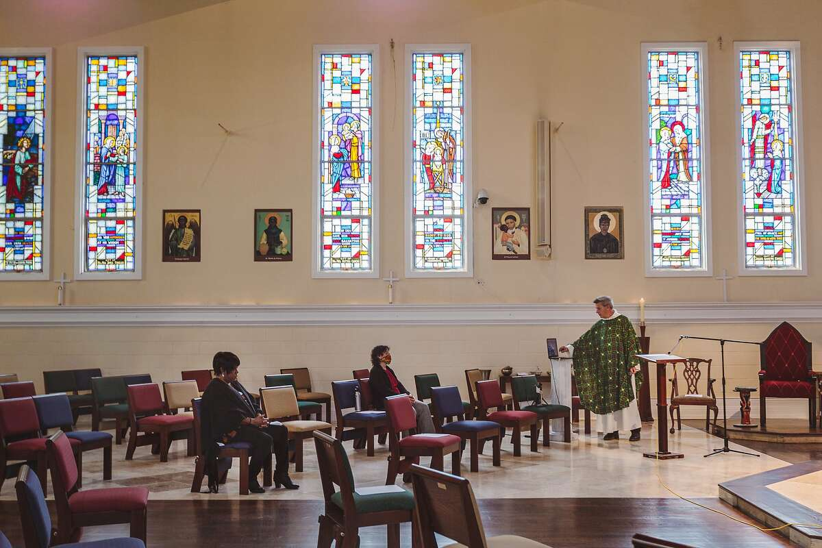 Father Aidan McAleenan facilitates an online mass service at St. Columba Catholic Church in Oakland, Calif. on Sunday, June 28, 2020.