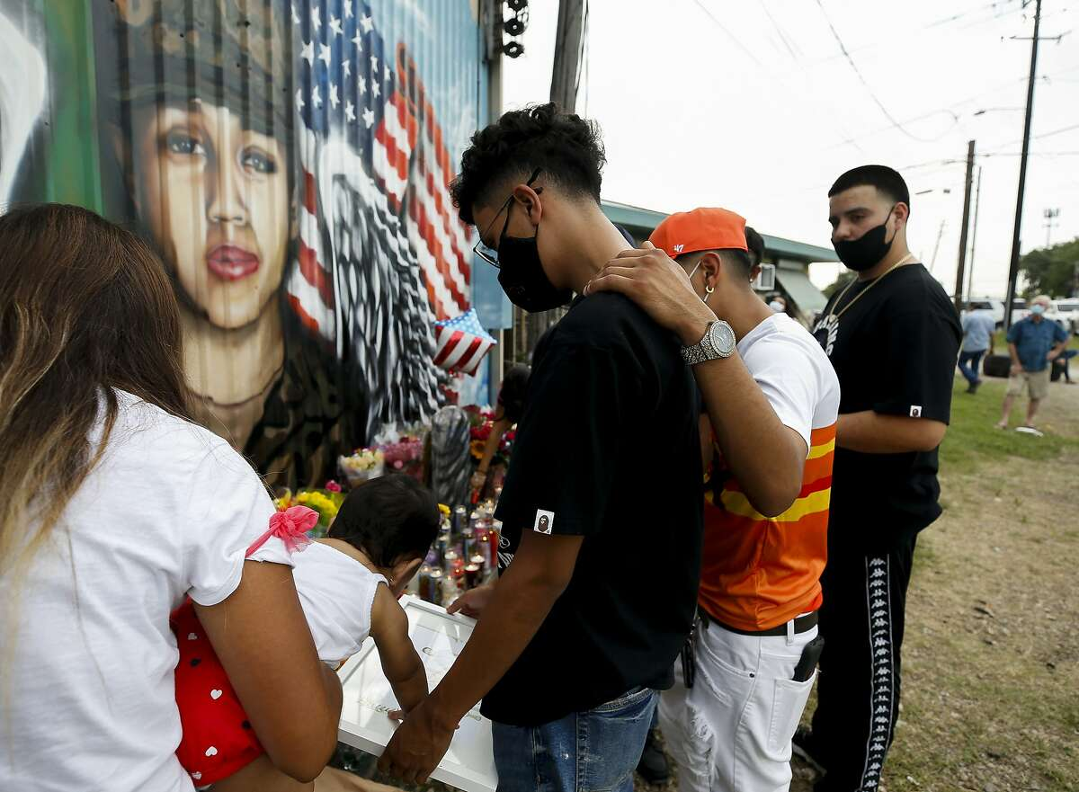 Juan Cruz, center, is comforted by friends as he looks at a drawing in front of the mural honoring his girlfriend, Houston native and Army Pfc. Vanessa Guillén, on Sunday, July 5, 2020, in Houston. Guillén, 20, who went missing in April was presumably killed by a fellow soldier. Godofredo A. Vásquez/Staff photographer