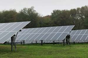 Above, a solar array at White Flower Farm in Litchfield. In Torrington, US Solar, a Minnesota-based company, is proposing a solar project on the city's landfill property.