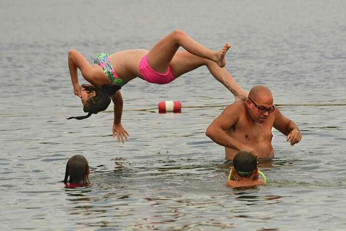 People enjoy cooling off in the fresh lake water at Grafton Lakes State Park beach on Tuesday, July 7, 2020 in Grafton, N.Y. (Lori Van Buren/Times Union)