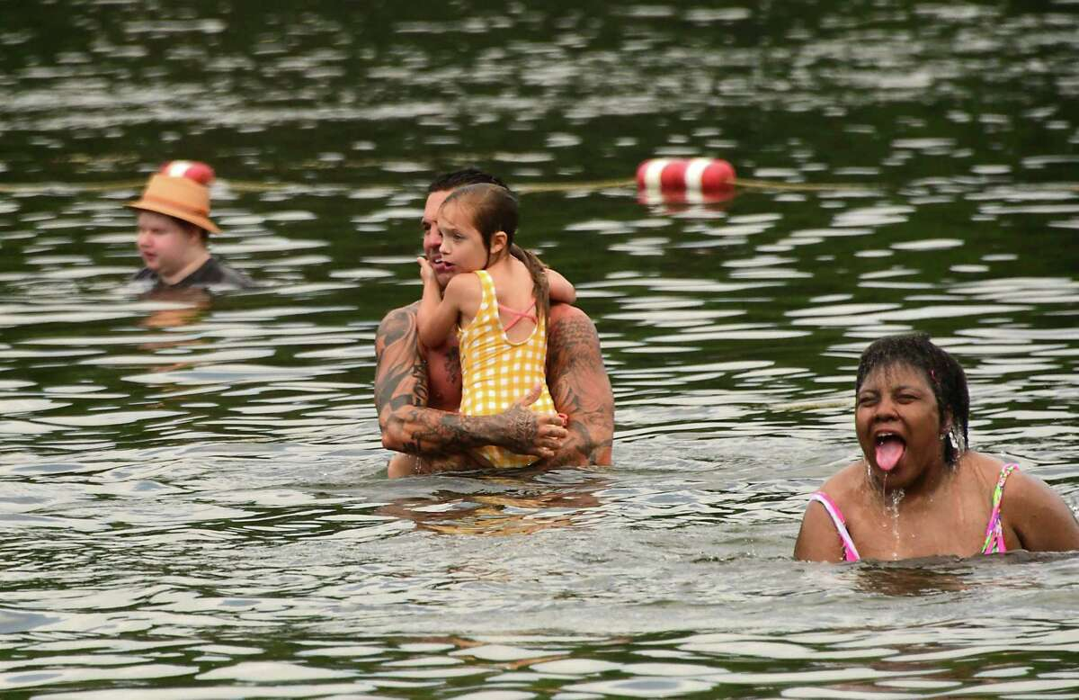 People enjoy cooling off in the fresh lake water at Grafton Lakes State Park beach on Tuesday, July 7, 2020 in Grafton, N.Y. (Lori Van Buren/Times Union)
