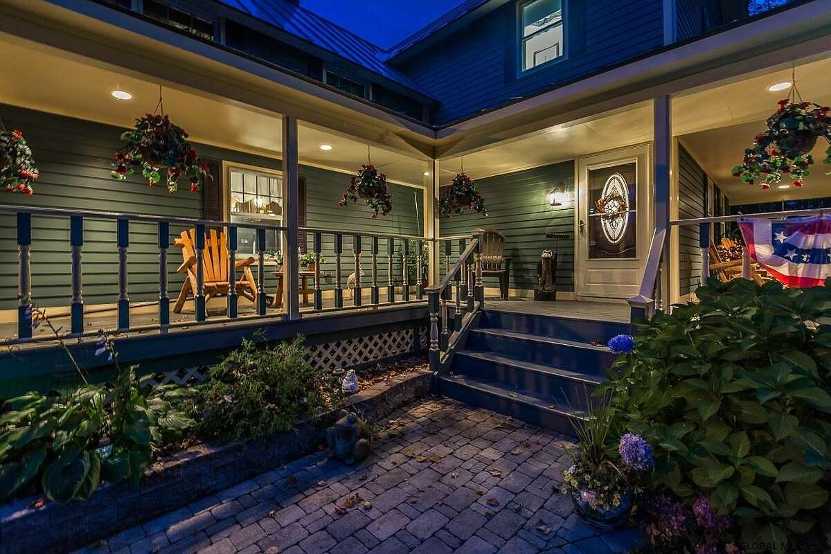 Scroll through the gallery below for a look at five Capital Region homes featuring stunning wrap-around front porches.