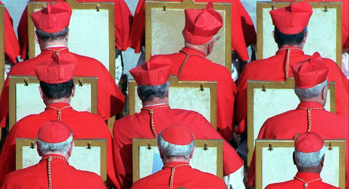 Old cardinals are seen during a 1998 Vatican City ceremony during which Pope John Paul II urged them to help lead the Catholic Church. The cardinal bird is named after the clergymen for their red crests and plumage, which resembles the red caps and robes of the clergymen.
