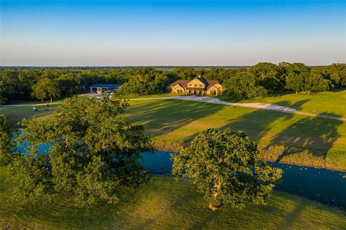 Sitting on 413.68 lot acres, the ranch-style home spans 5,767 square feet.