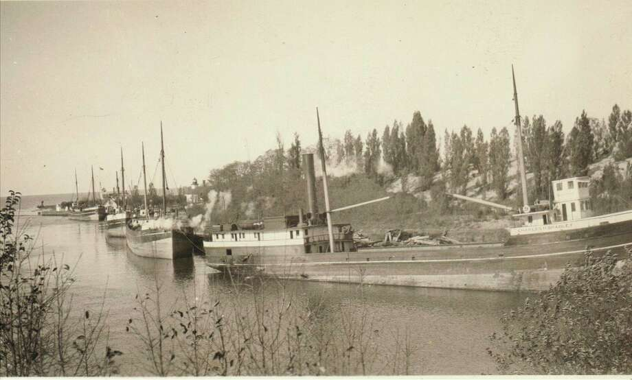 One of the popular ways of shipping lumber and other items to Manistee and other ports of destination around the Great Lakes in the 1890s and early 1900s were schooners that line the Manistee River Channel in this picture.