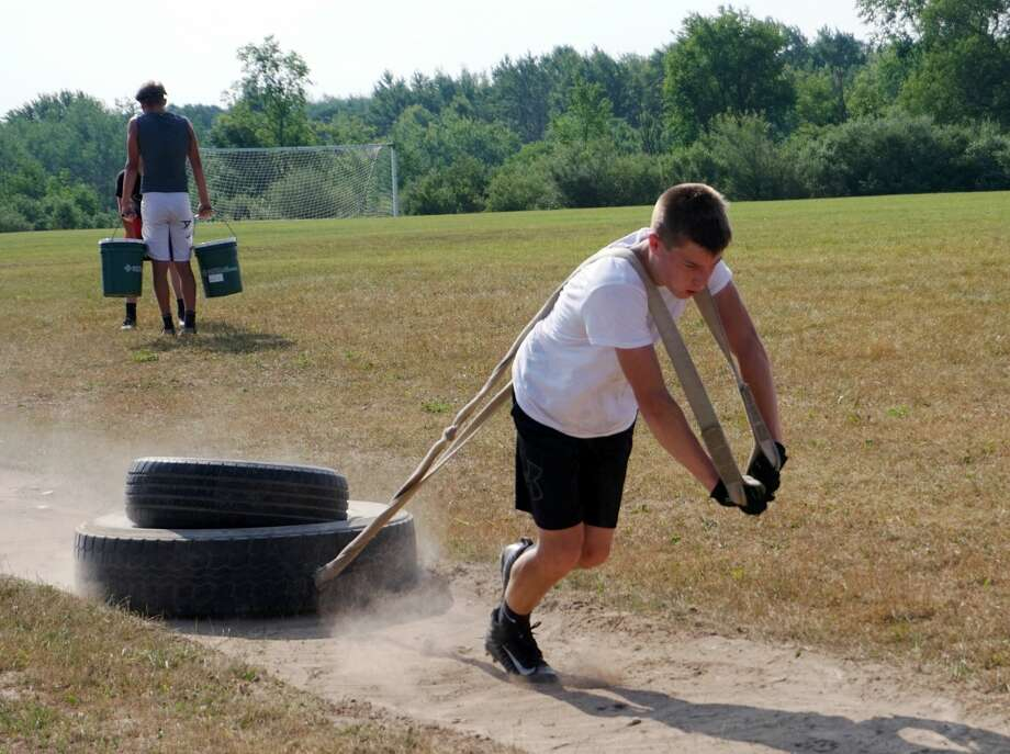 With pads, helmets, indoor workouts and contact of all kinds still prohibited, the Reed City High School football team has been utilizing tractor tires for various conditioning exercises. Photo: Joe Judd