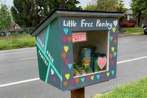 A Little Free Pantry is stocked with non-perishable food.