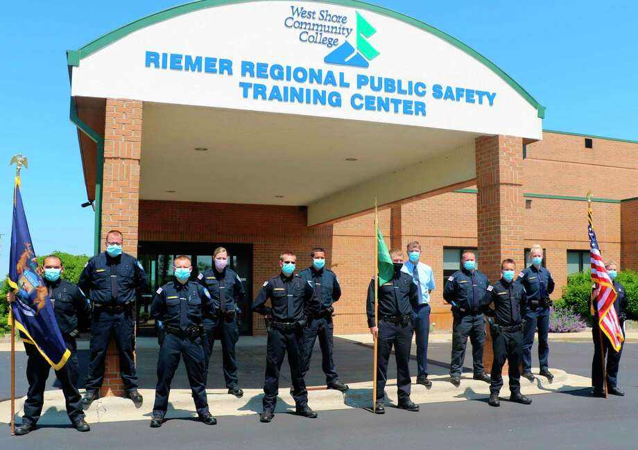 The 2020 West Shore Community College Police Academy graduates stand in front of the Riemer Regional Public Safety Training Center following their graduation. The class had to overcome many obstacles on the way to graduation due to the COVID-19 pandemic. (Courtesy photo)