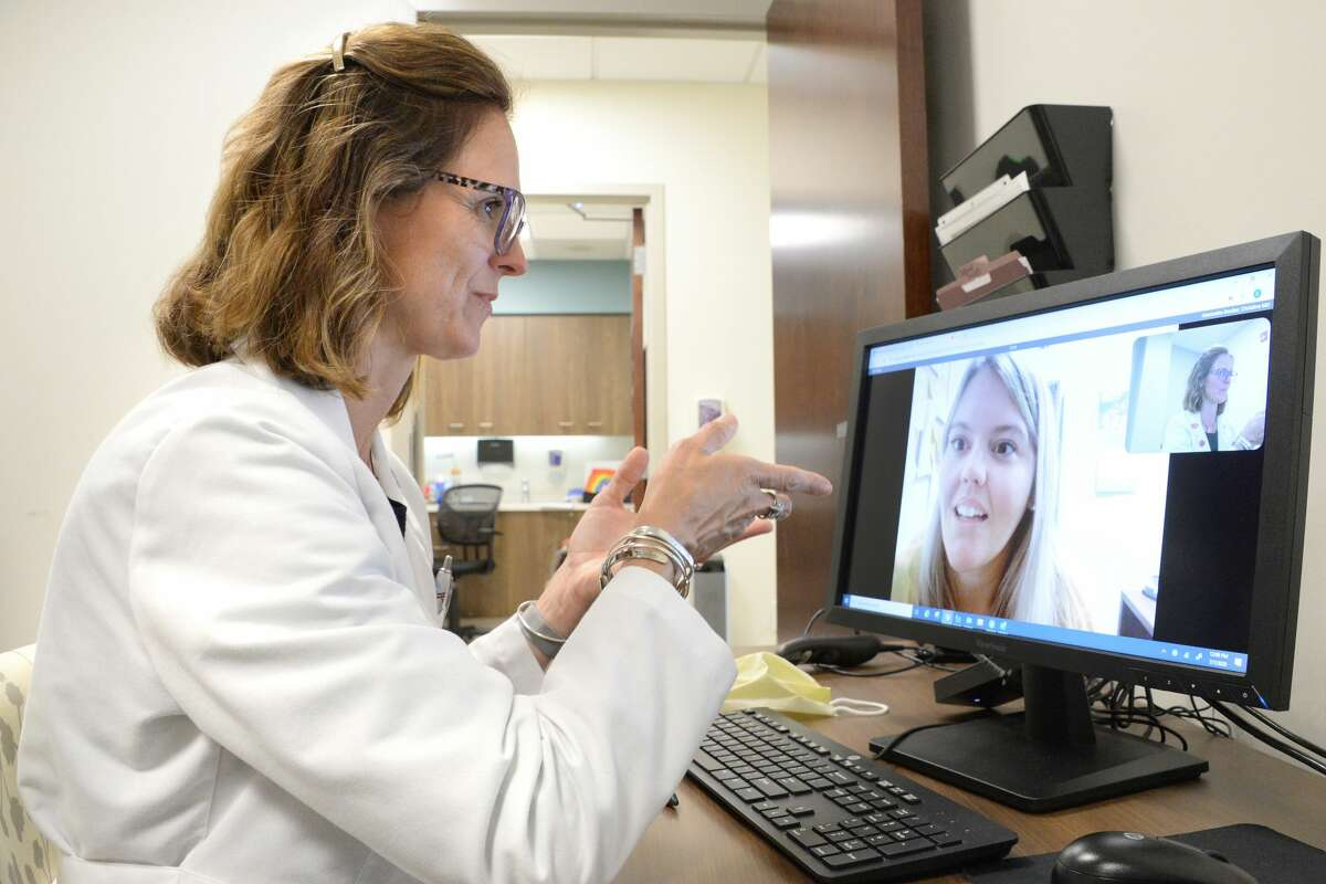 Dr. Christine Alexander-Decker, an endocrinologist with Saratoga Hospital Medical Group, conducts a telemedicine visit with a patient on Tuesday, July 7, 2020 from inside her office in Wilton, N.Y.