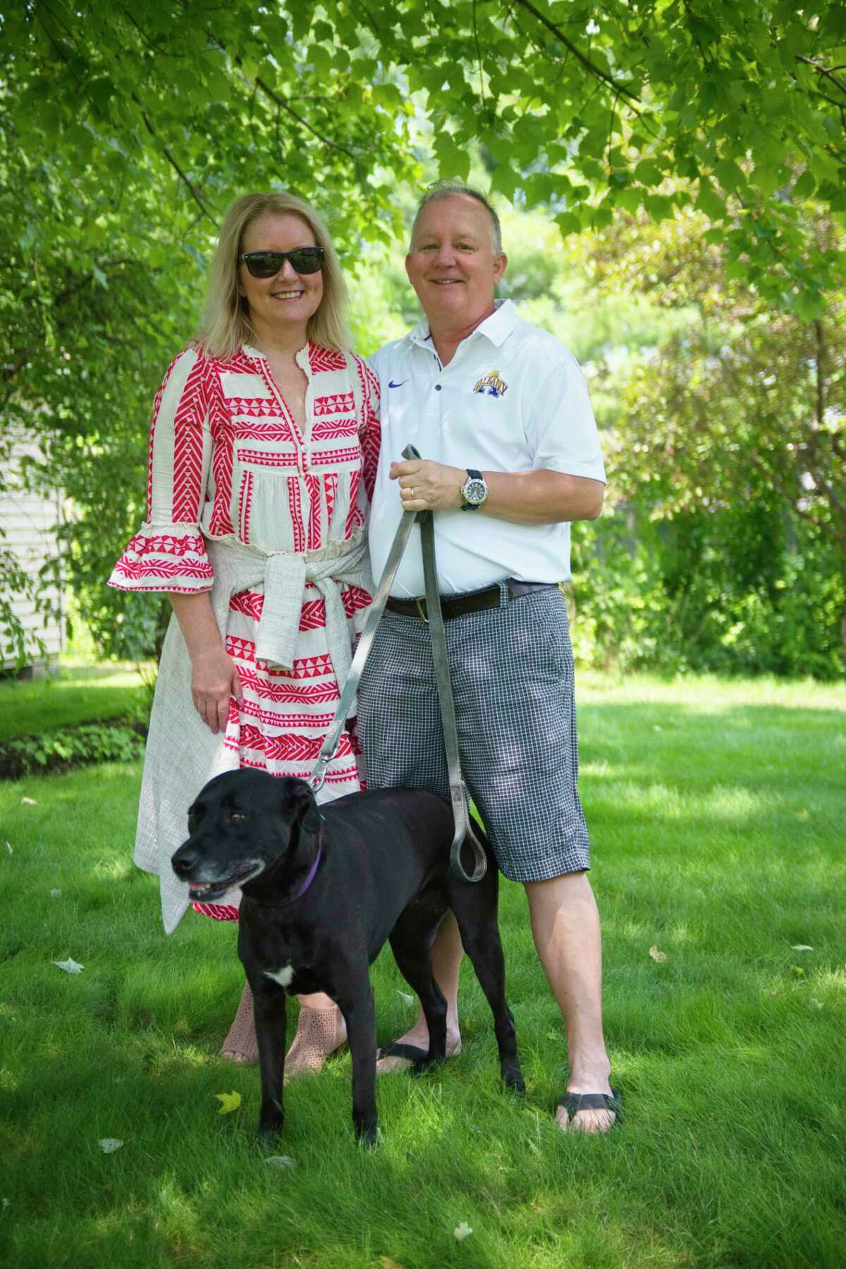 Times Union columnist and Writers Institute Director Paul Grondahl with his wife Mary O'Donnell Grondahl and their dog Lily on Tuesday, July 7, 2020, in Guilderland, N.Y. Grondahl survived a nasty bout with bacterial pneumonia that doctors initially believed was COVID-19. (Paul Buckowski/Times Union)