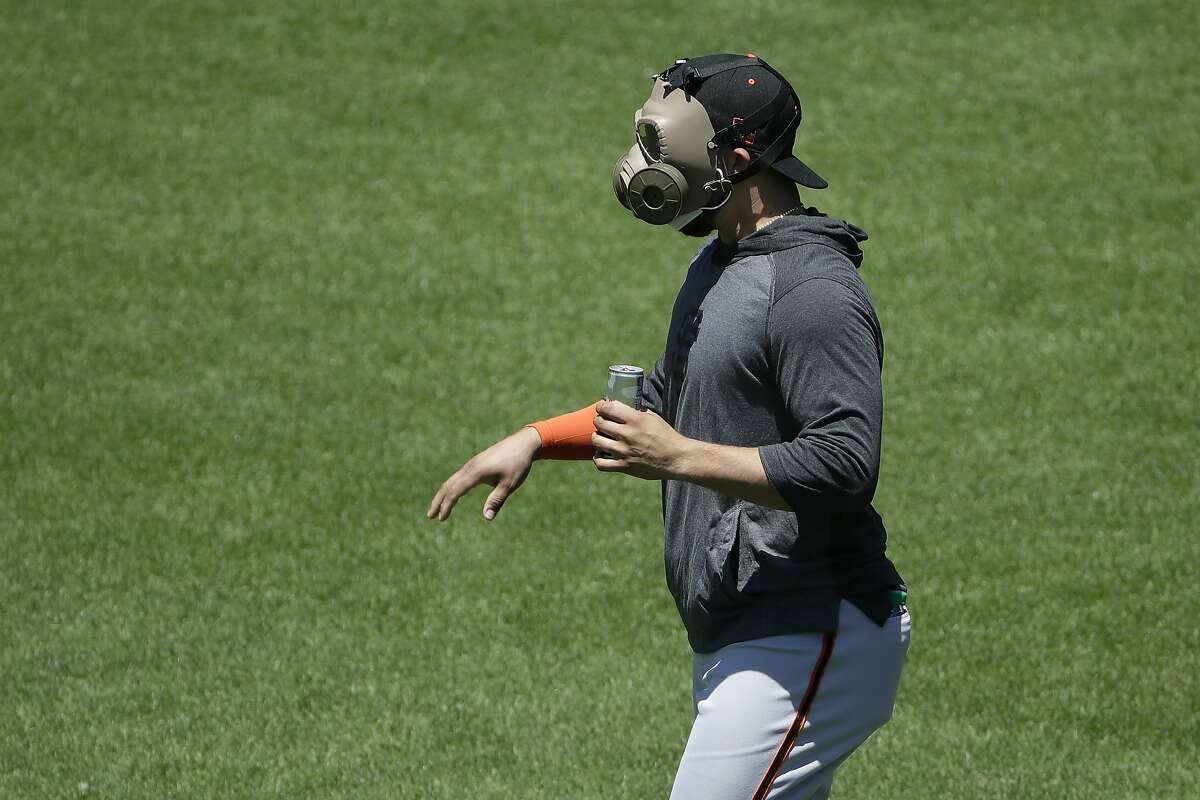 San Francisco Giants' Yolmer Sanchez wears a mask during a baseball practice in San Francisco, Sunday, July 5, 2020.