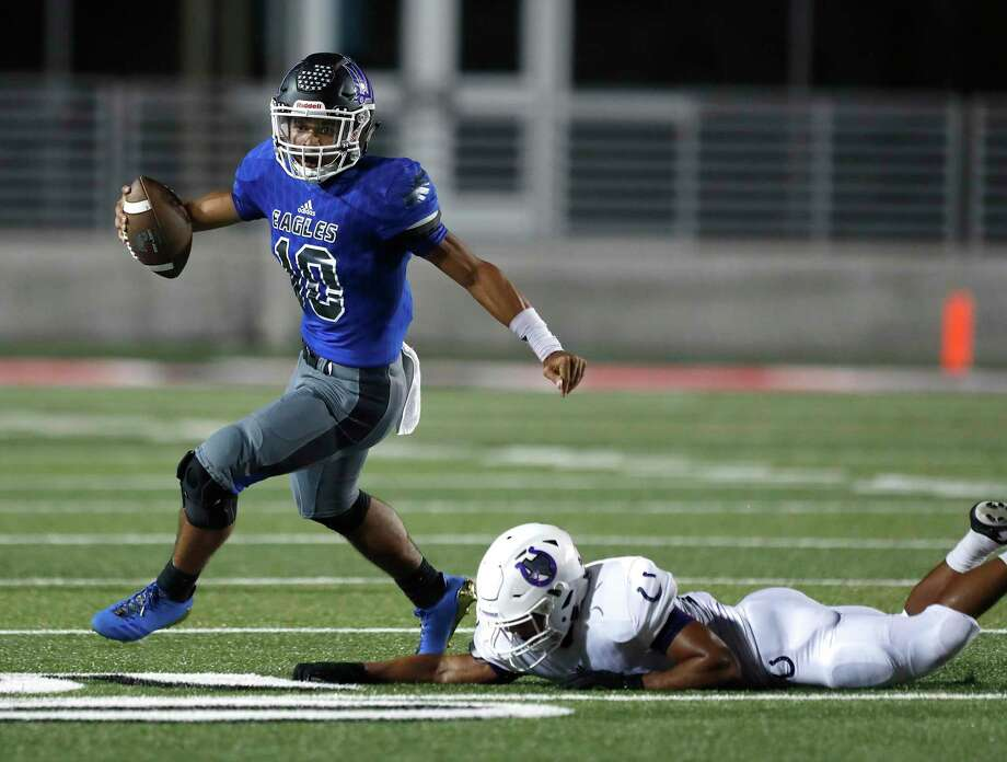 New Caney's QB Jordan Cooper (10) tries to shake off Dayton's Hedil Cuatianquiz (15) during the first half of a high school fiootball game at Texan Drive Stadium, Friday, Sept. 29, 2017, in Porter. ( Karen Warren / Houston Chronicle ) Photo: Karen Warren, Staff / Houston Chronicle / @ 2017 Houston Chronicle