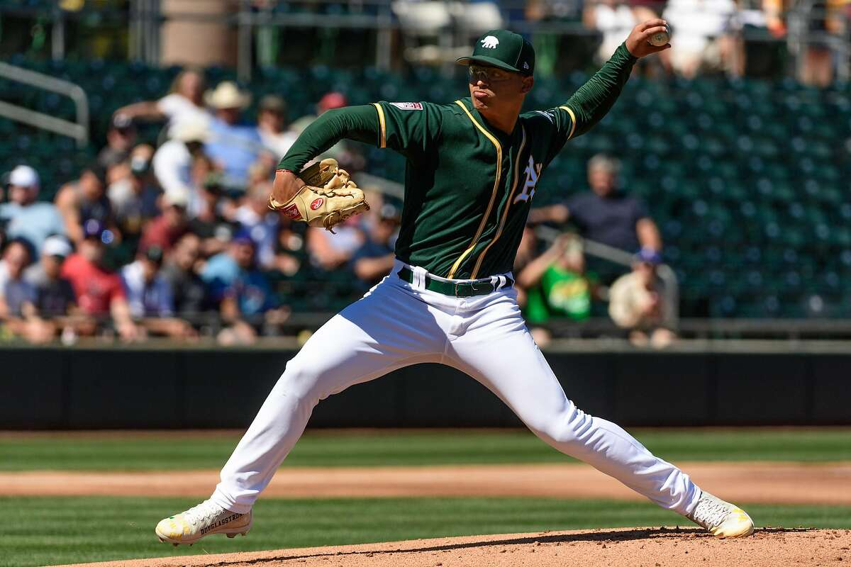 MESA, ARIZONA - MARCH 05: Jesus Luzardo #44 of the Oakland Athletics delivers a pitch during the spring training game against the Texas Rangers at HoHoKam Stadium on March 05, 2019 in Mesa, Arizona. ~~