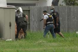 Houston police officers took a man into custody using a police canine near the 2200 block of Airline Drive on Monday, July 6, 2020. The suspect, identified as 30-year-old Shannon Washington, was later charged with attacking an assist animal.