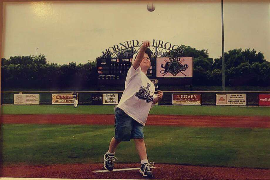 Caedmon Parker throws from the mound at TCU's Lupton Baseball Stadium as a child. Last week, Parker, a TWCA senior, committed to play baseball for the Horned Frogs. Photo: Caedmon Parker / Twitter