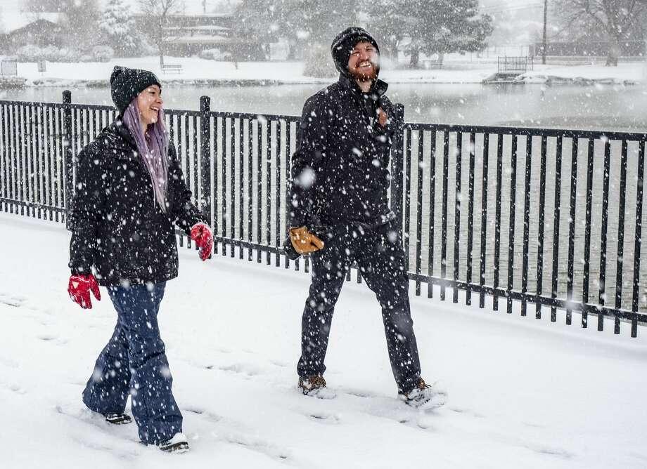 Carra Roye and Logan Joiner enjoy a quiet snow covered walk 02/05/2020 around Wadley Barron Park. Tim Fischer/Reporter-Telegram Photo: Tim Fischer/Midland Reporter-Telegram / Midland Reporter-Telegram