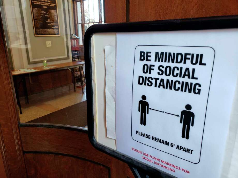 Manistee City Hall reopened Tuesday after being closed to the public since March 17 during the pandemic. The building now features one-way traffic flow, hand sanitizing stations, mask requirements and social distancing reminders. (Arielle Breen/News Advocate)