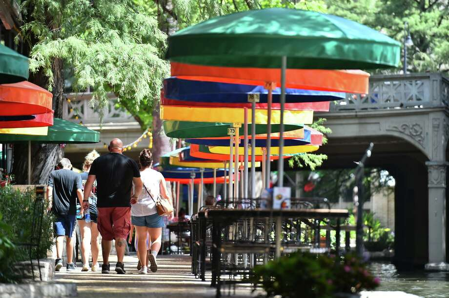Visitors walk along the River Walk on the Fourth of July. COVID-19 has taken a toll on the city's leisure and hospitality industry. Photo: Robin Jerstad /Contributor / **MANDATORY CREDIT FOR PHOTOG AND SAN ANTONIO EXPRESS-NEWS/NO SALES/MAGS OUT/TV